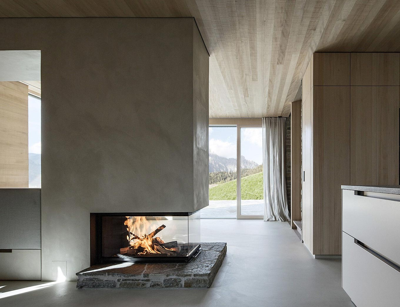 Minimalist Concrete Fireplace In A Striking Home Situated