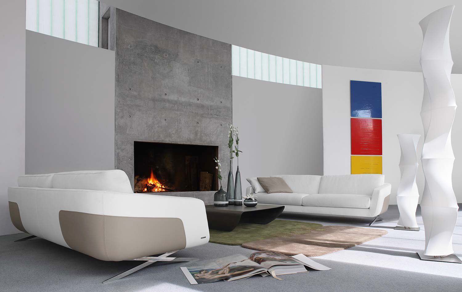 White living room with huge concrete fireplace