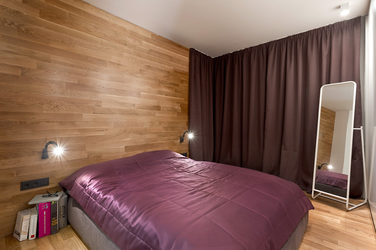 Minimalist bedroom wtih wooden walls