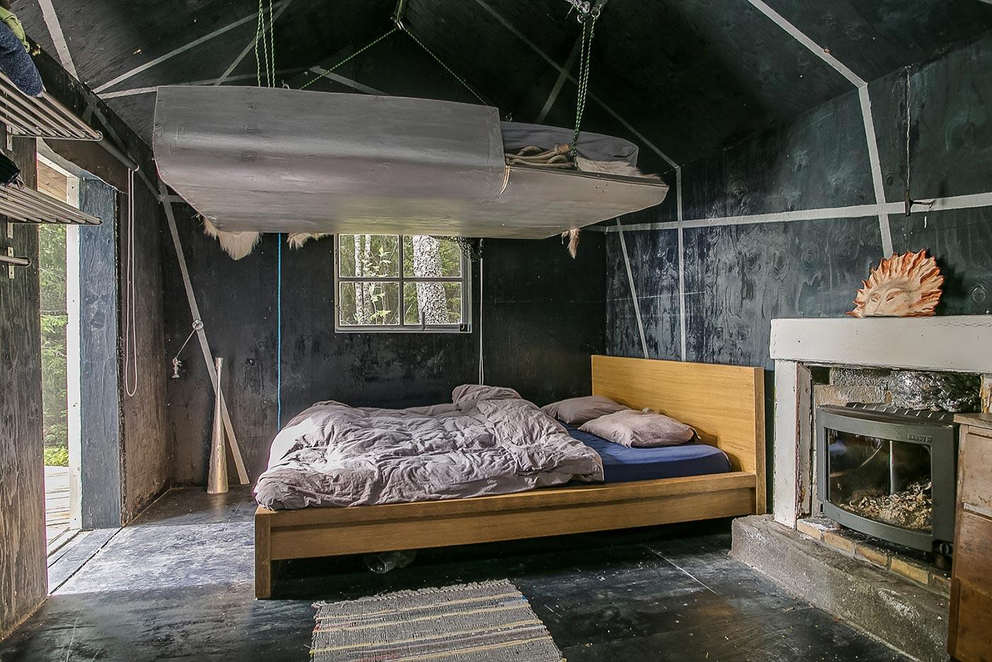Dark bedroom with a loft bed