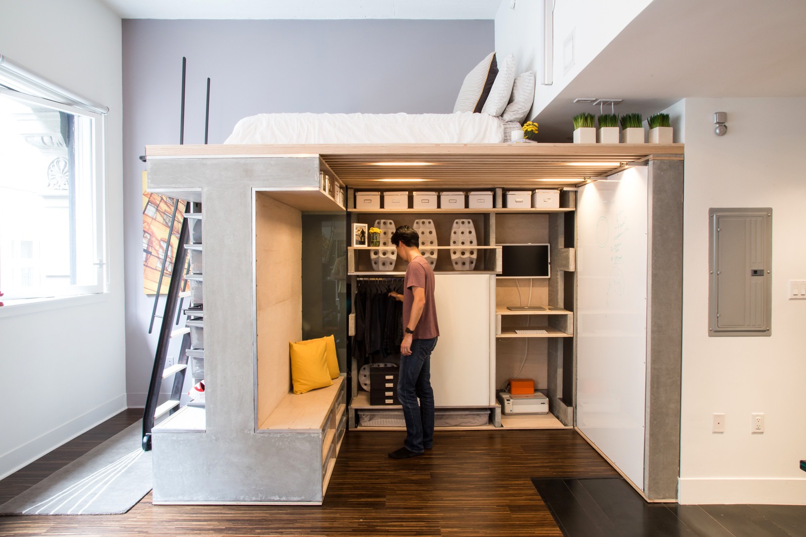 Multi-functional loft unit with a hidden closet