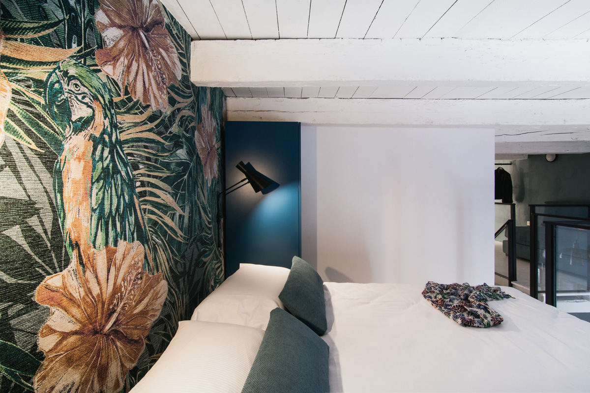 Loft bedroom with tropical featured wall