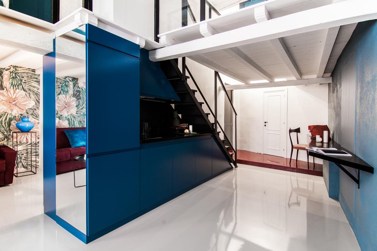 Dark blue kitchen that serves as a divider