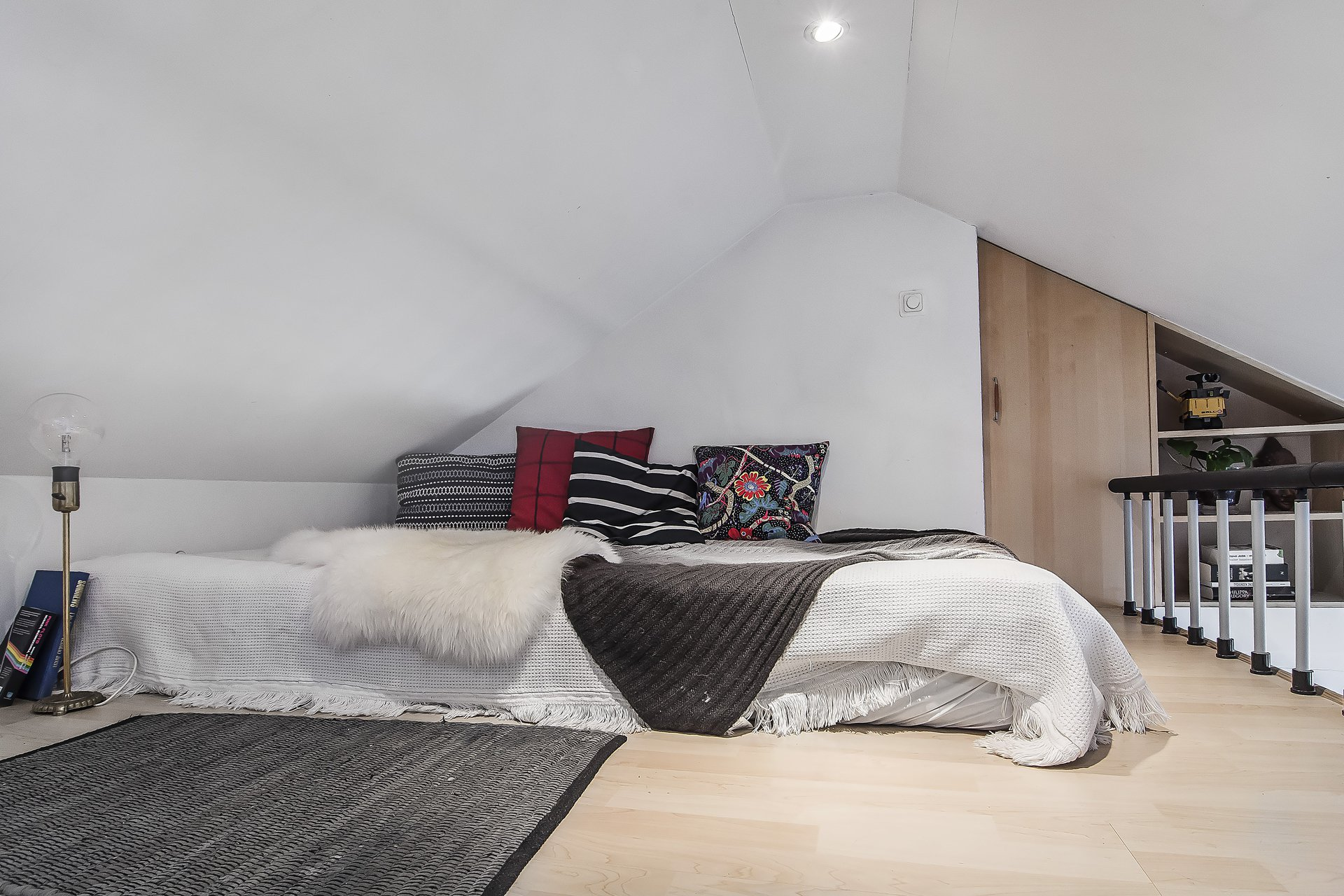 Attic bedroom in a black and white loft