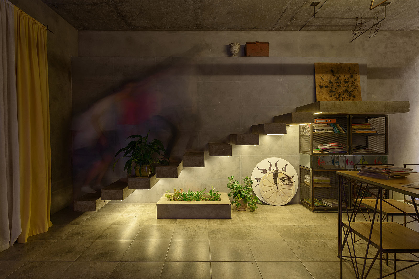 Floating staircase in an industrial style loft - night photo
