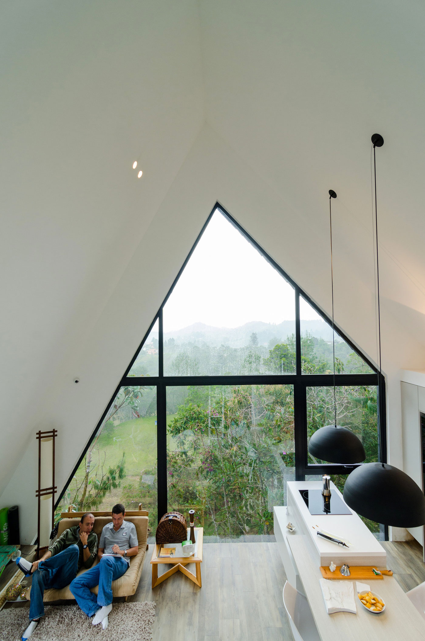 Modern home with A-frame panoramic window