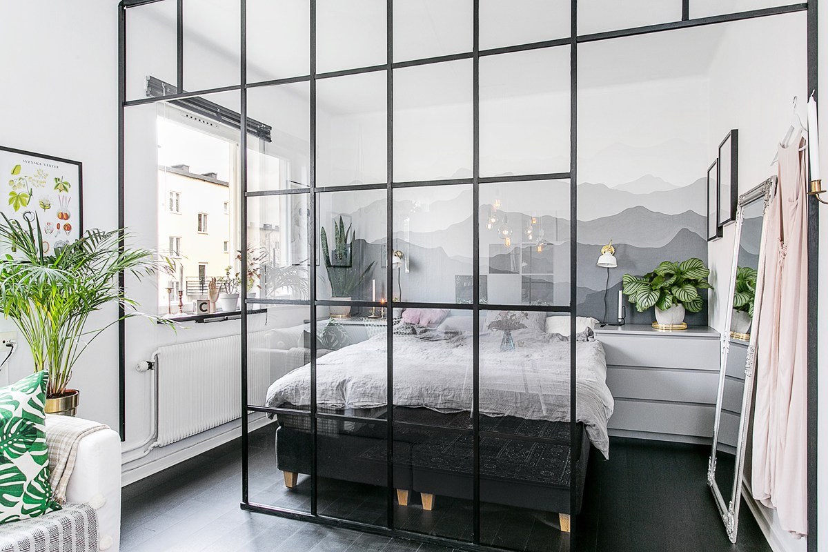 Tiny bedroom with a glass divider