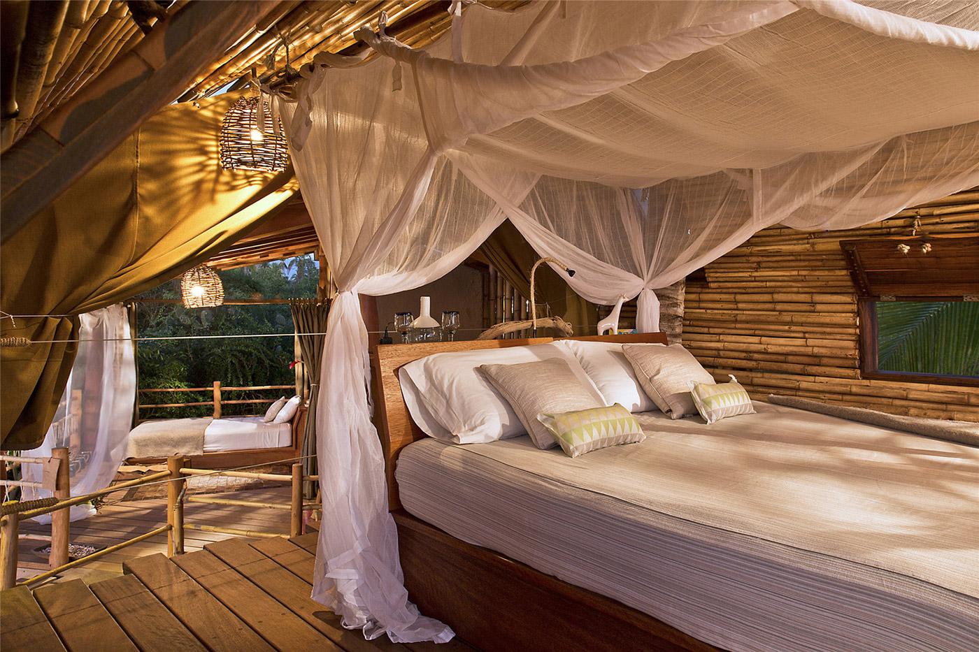 Canopy bed in a bamboo cabin