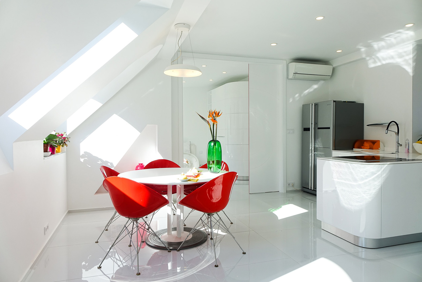 White interior with red chairs