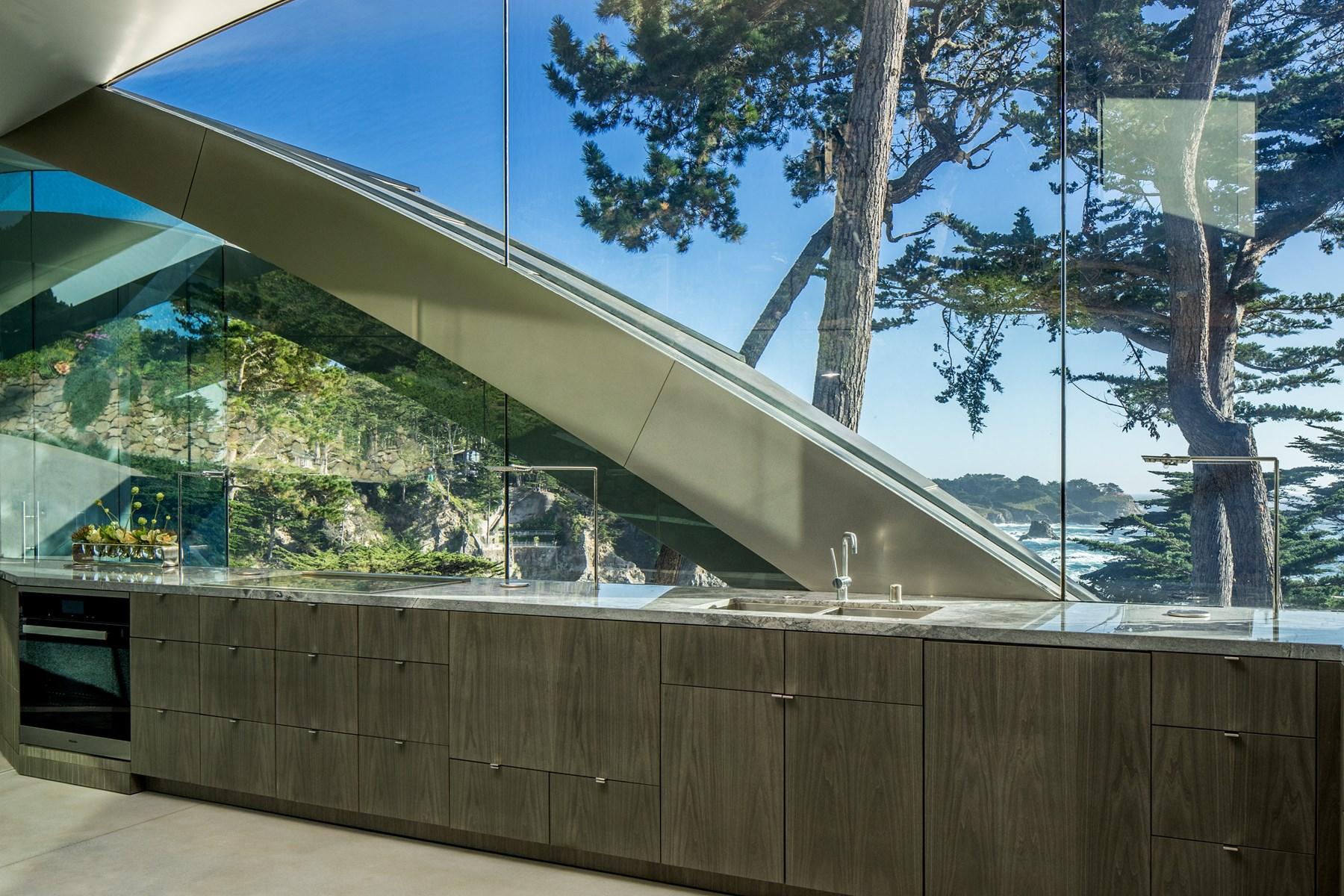 Modern kitchen with glass windows