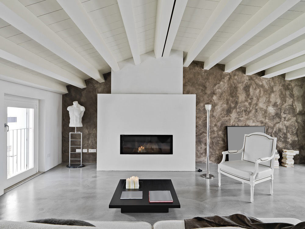 Contemporary attice with a fireplace