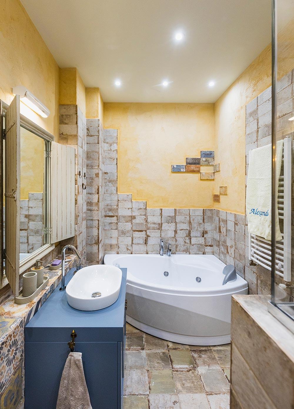 Bathroom with a corner bath