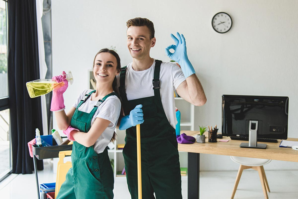 Happy couple cleaning their home