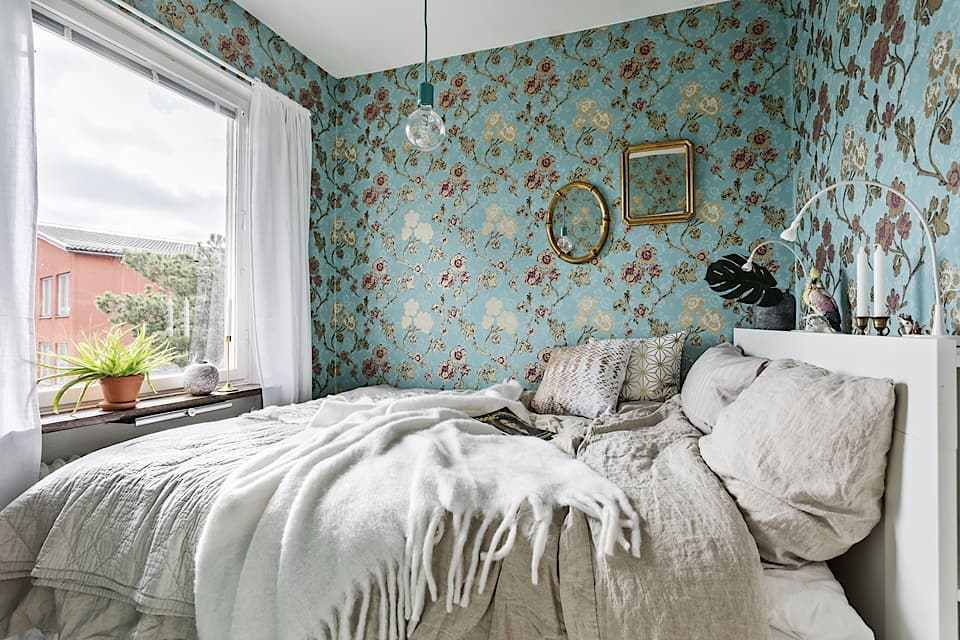 Tiny bedroom with wallpapers