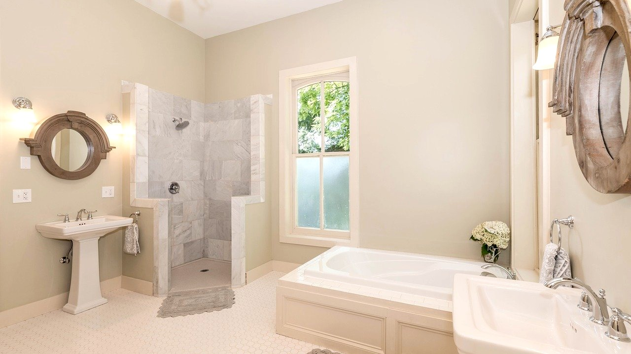 Bathroom with tub and shower enclosure