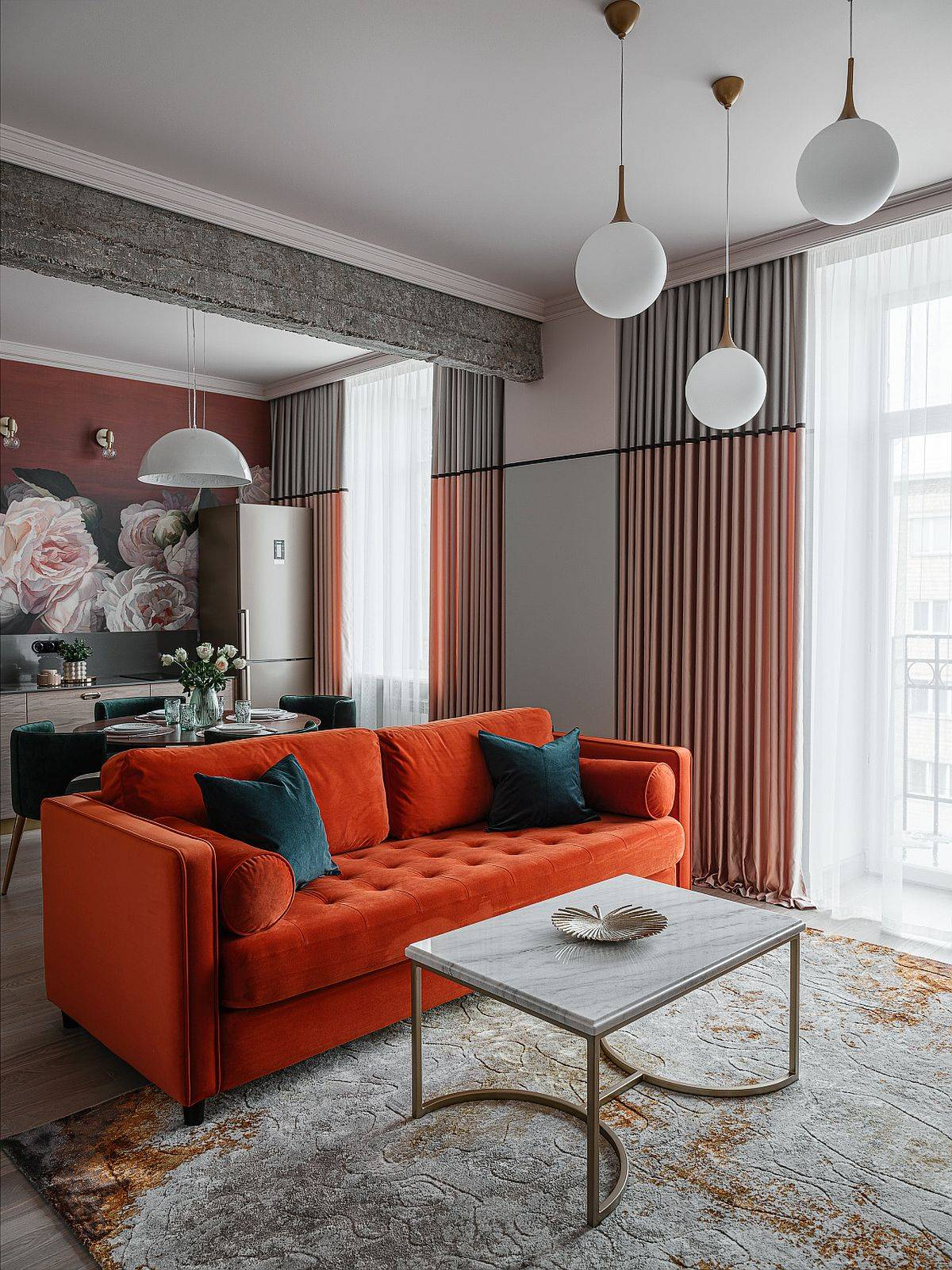 Modern living room with a vibrant orange couch