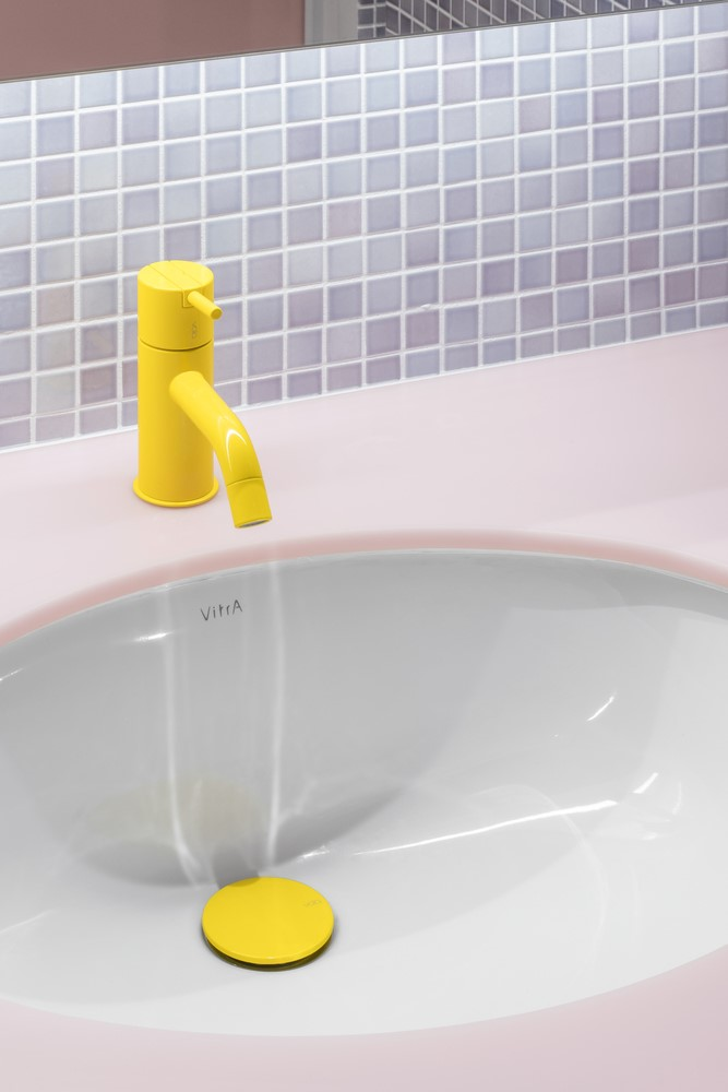 Pink and yellow bathroom sink
