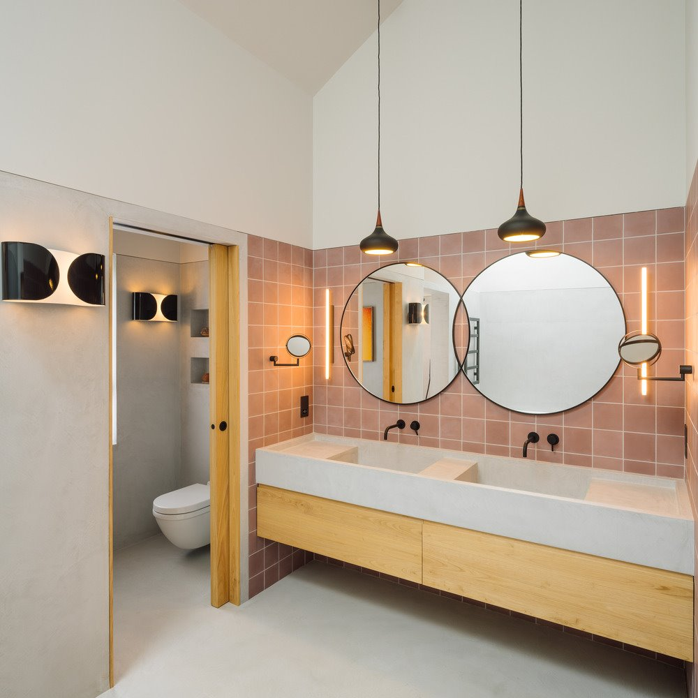 Modern bathroom with pink tiles