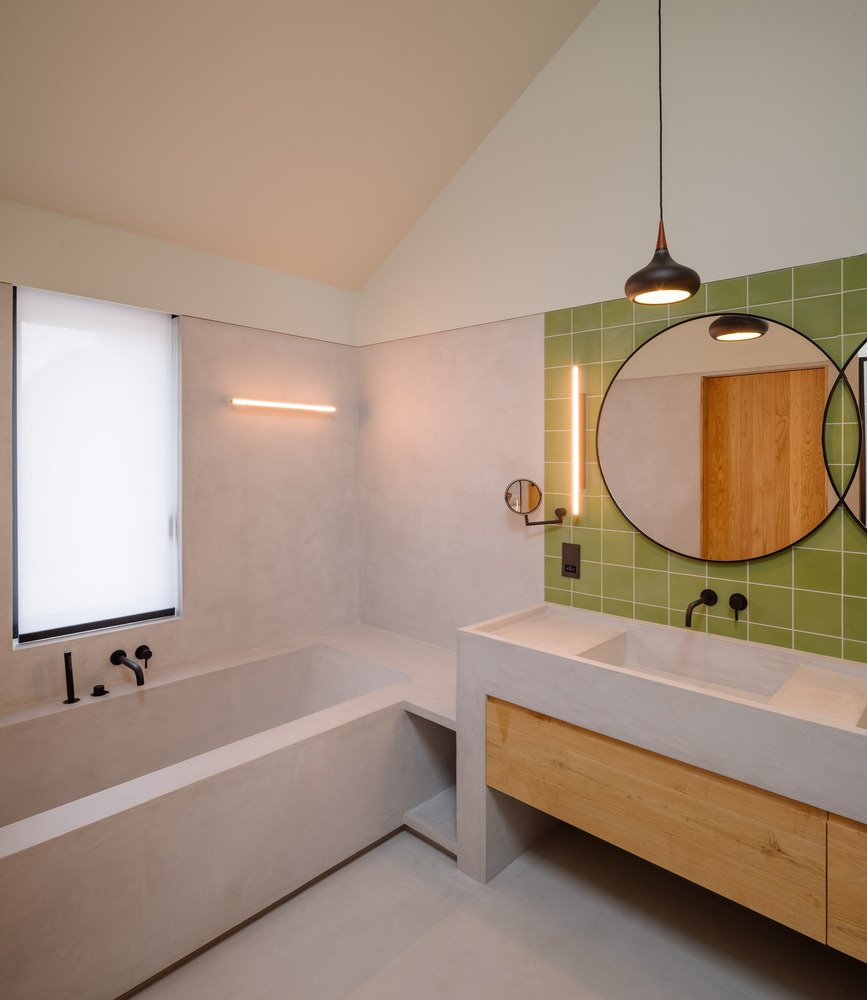 Modern bathroom with green tiles