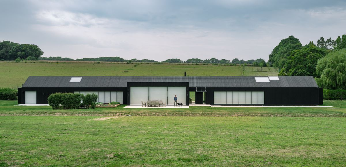 Contemporary barn house with black cladding