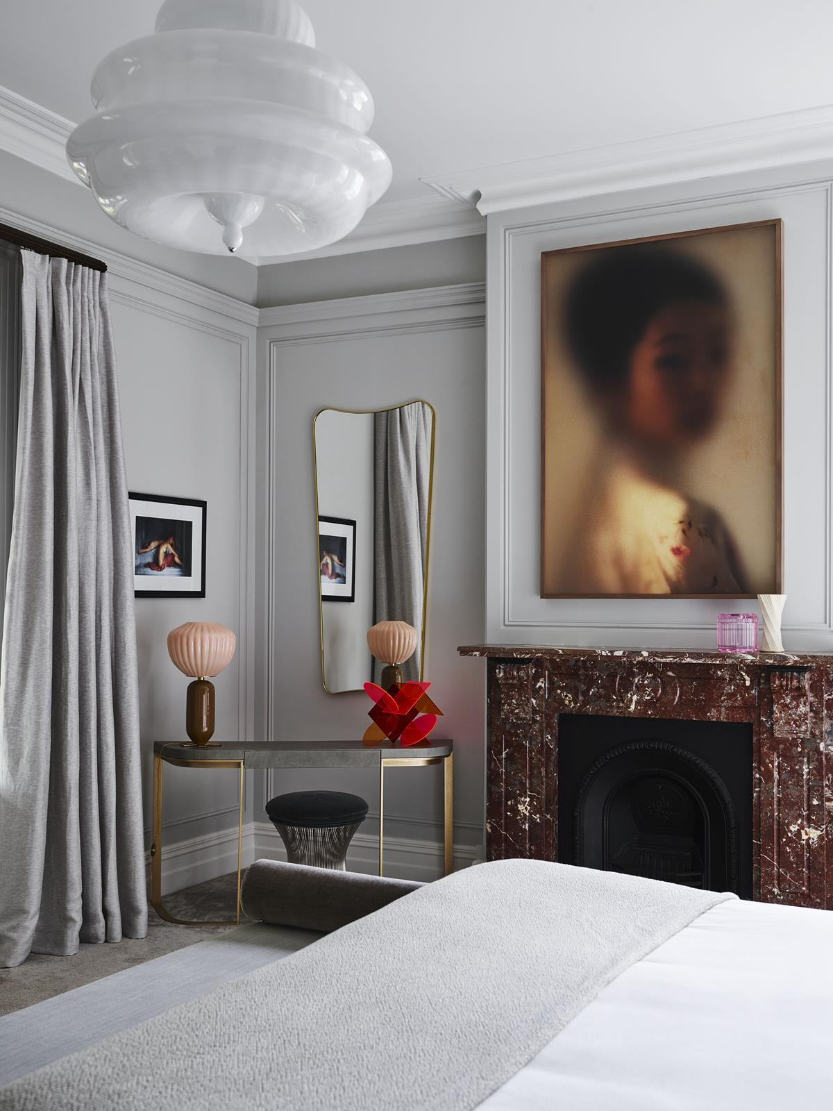 Bedroom with a marble fireplace