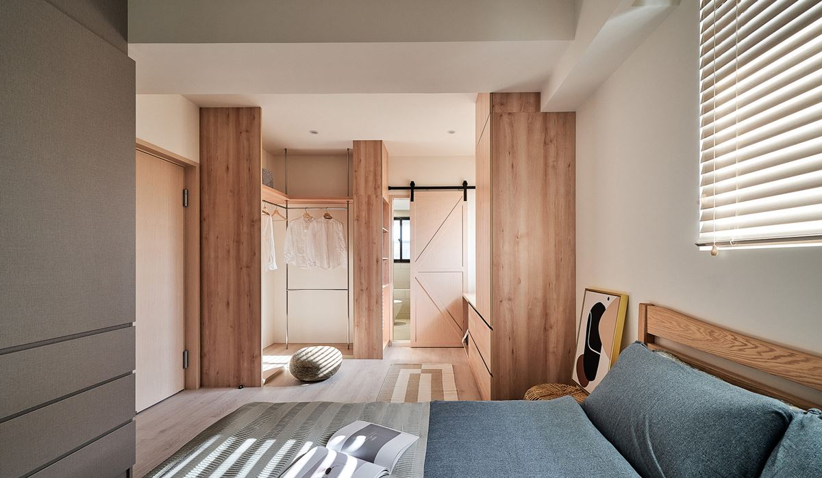 Wooden bedroom with an en-suit bathroom