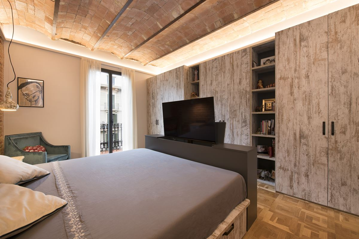 Bedroom with a built in TV