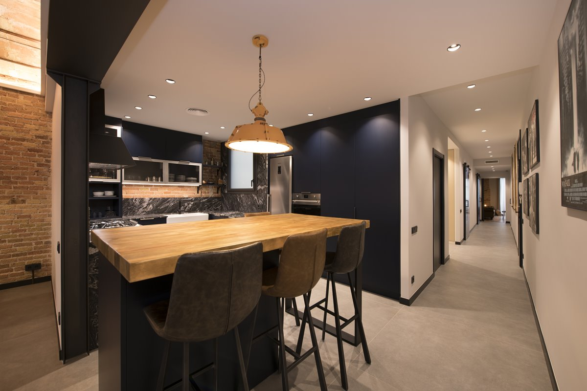 Industrial kitchen with a bar table