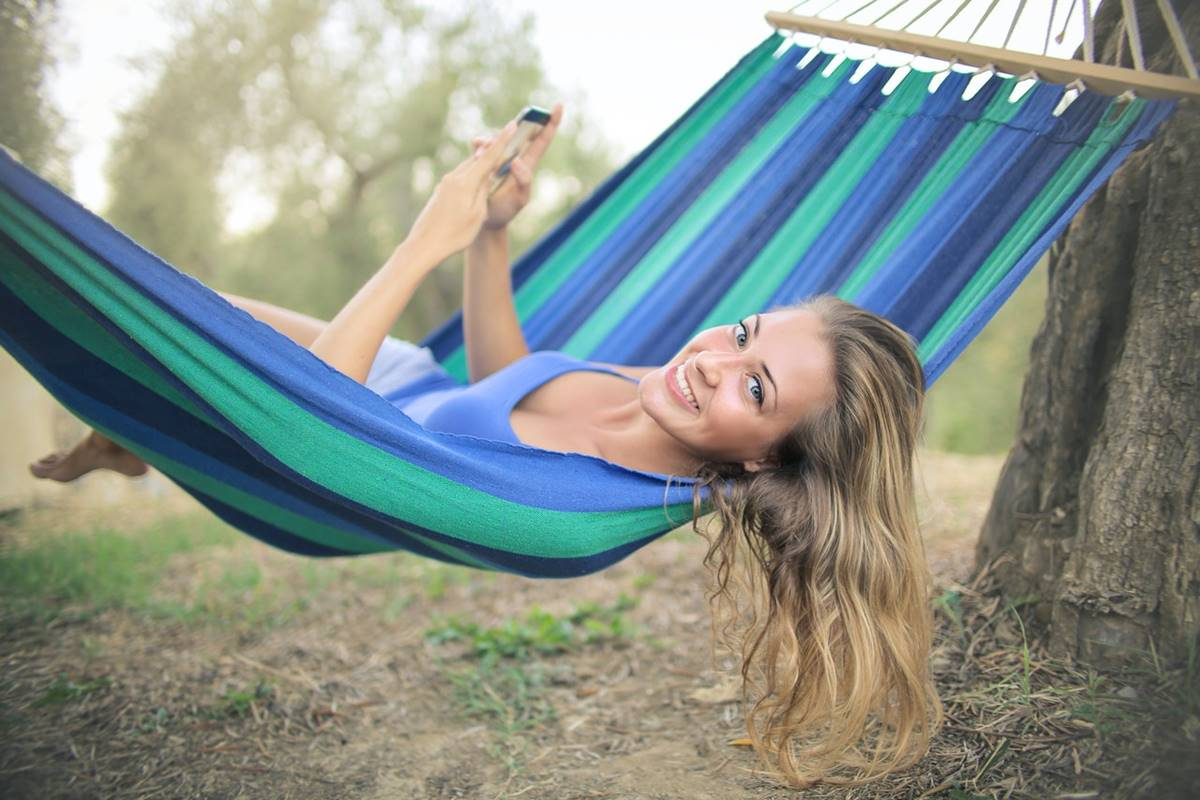 Lying in a hammock