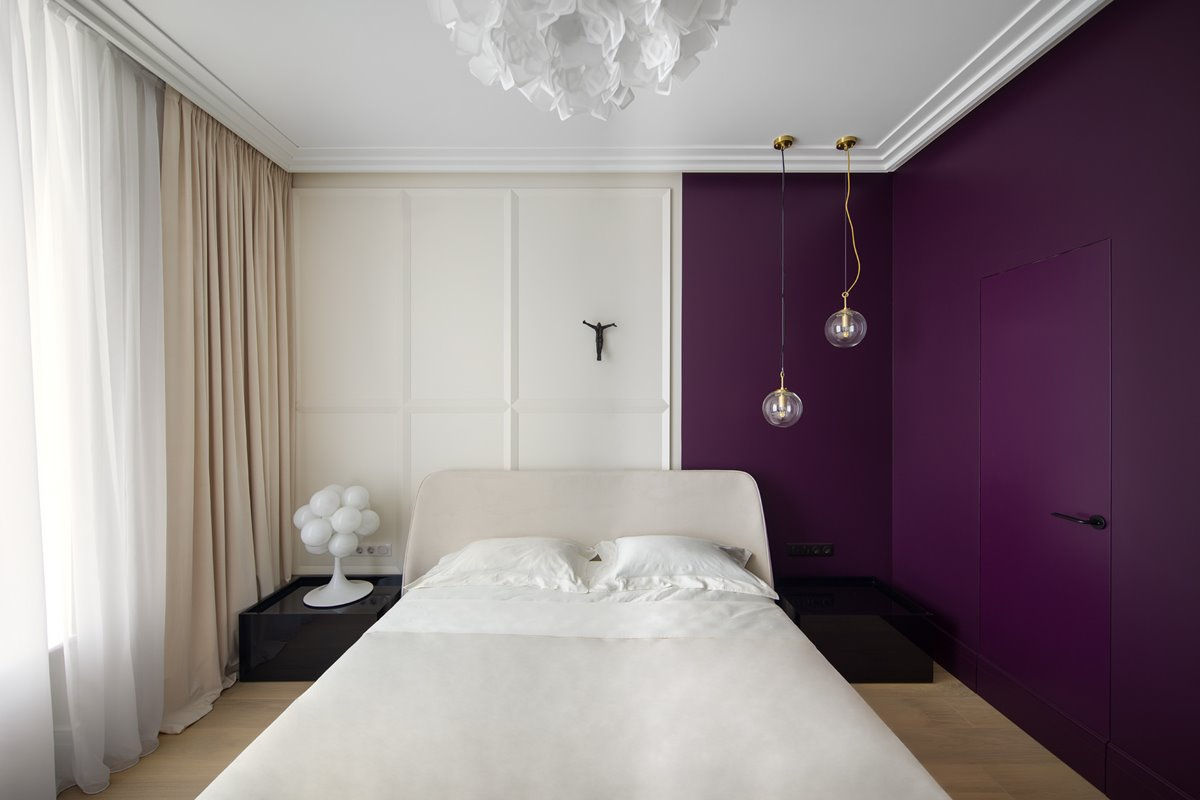 Modern guest bedroom in white and purple