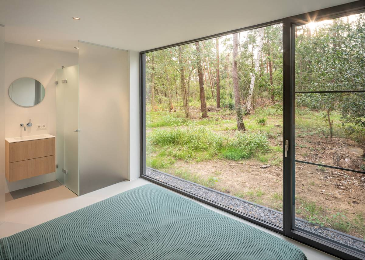 Spacious bathroom with a forest view
