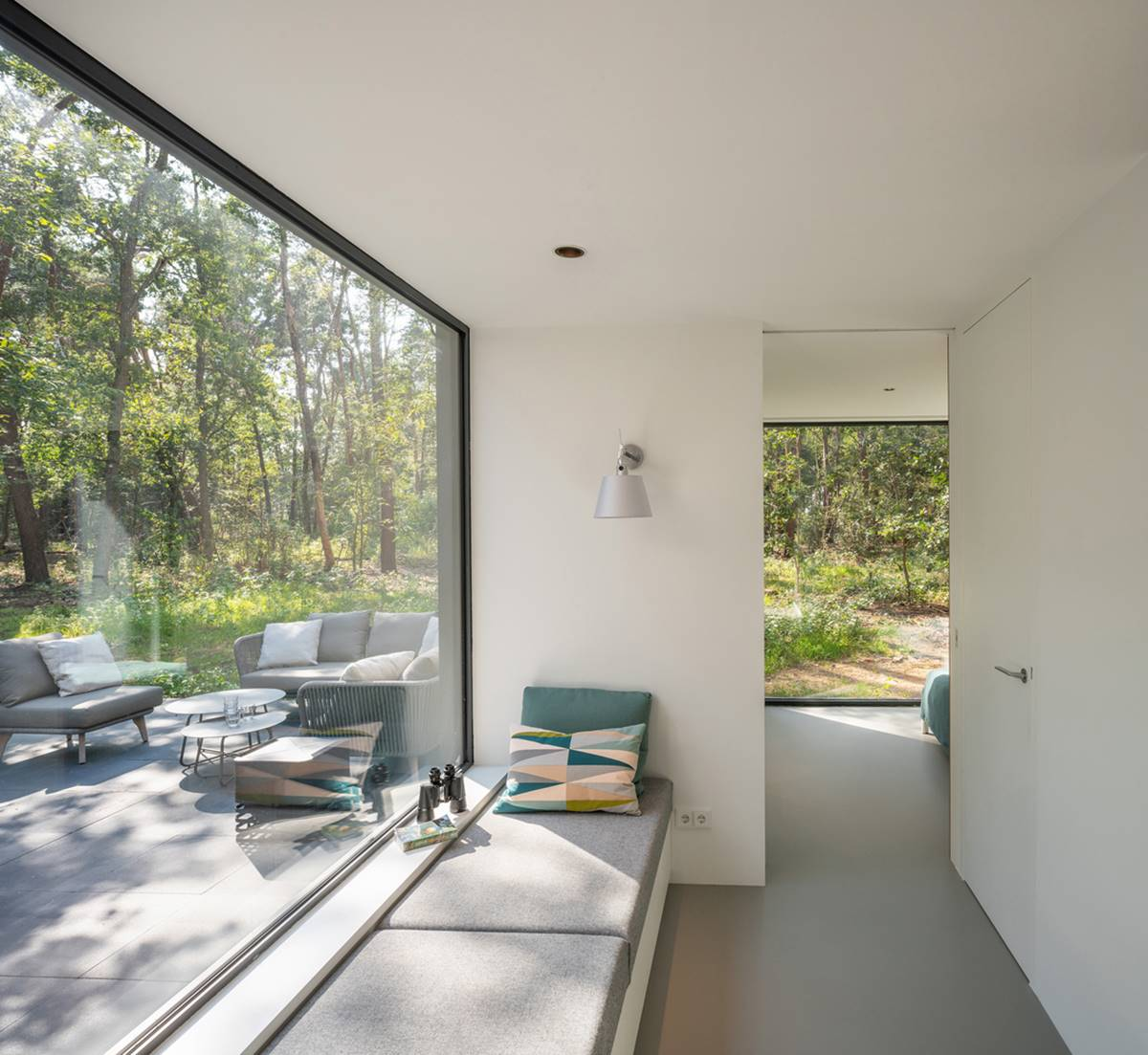 Panoramic window in a forest villa
